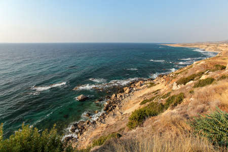Evening sun shines on rough coast of Mediterranean Sea in Karpass region of Northern Cyprus
