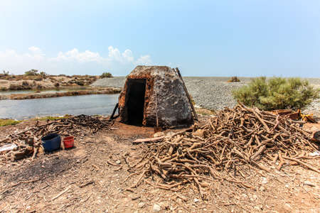 Small stone oven on the beach, used to burn tree roots for charcoal
