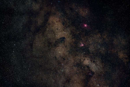 Night summer sky with milky way near Scutum constellation, bright Sagittarius clouds, purple Eagle and Swan nebula visible. Long exposure stacked photo Stock fotó
