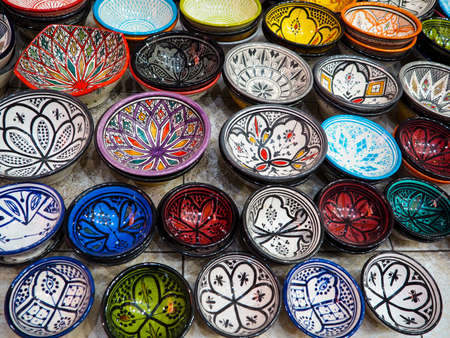 Handmade colourful decorated bowls or cups on display at traditional souk - street market in Morocco Stock fotó