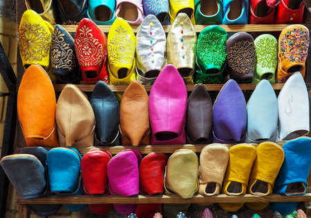 Handmade colourful leather slippers on display at traditional souk - street market in Morocco Stock fotó