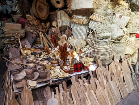 Wooden handmade bowls, spoons, boards, kitchen utensils and baskets on display at street market Stock fotó