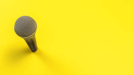 Black microphone with silver grind on yellow board, space for text right Stock fotó