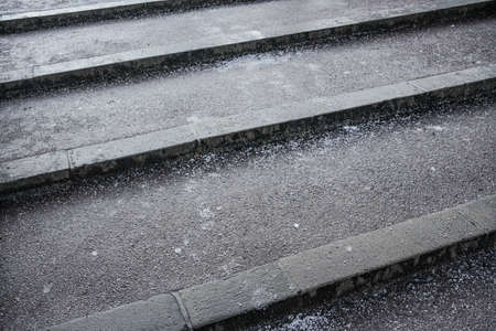 Crystals of salt on stairs, these gets slippery in winter when layer of ice forms top of surface