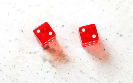 Two red craps dices showing Hard Four / Little Joe (double number two) overhead shot on white board Stock fotó