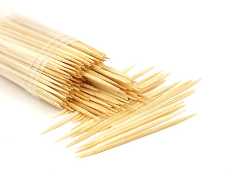 Stray pack of toothpicks on white background