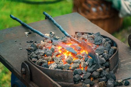 Blacksmith, smithy and blacksmith tools  - Folk art Stock Photo