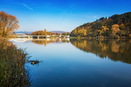 Bridge in Piestany (Slovakia), Vah river + blue sky + colorful autumn 写真素材