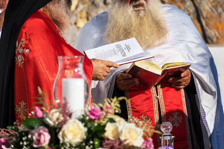 Priests during Wedding ceremony in St. Paul´s bay on Rhodes, Greece