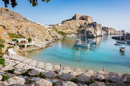 St. Paul´s bay with boats, Lindos acropolis in background (Rhodes, Greece) Stock Photo
