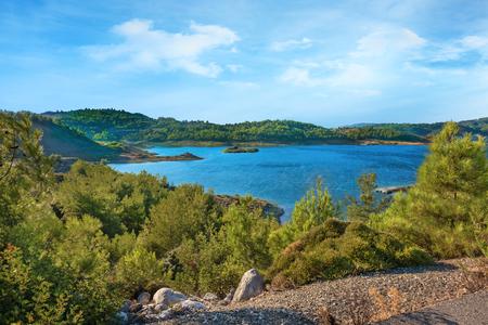 Wild nature around reservoir of Gadoura Dam on Rhodes Island (Rhodes, Greece)