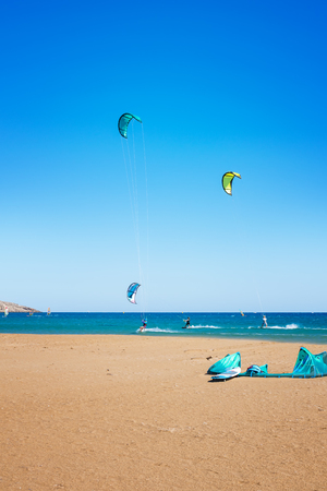 Waves and kiteboarders on Prasonisi beach (Rhodes, Greece)