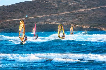 Windsurfers and kitesurfers ride on Prasonisi beach (Rhodes, Greece) Stock Photo