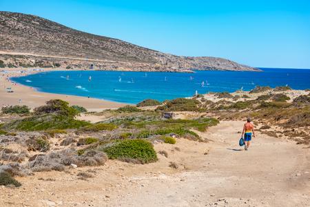 Man walking to Prasonisi beach full of windsurfers (Rhodes, Greece)