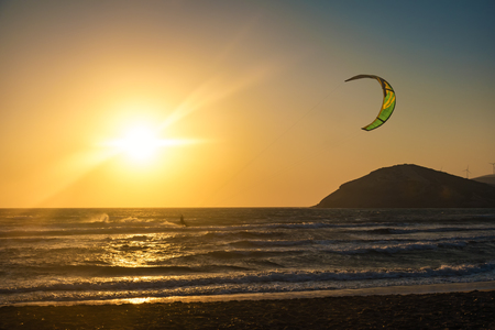 Sunset on Prasonisi beach with kitesurfer (Rhodes, Greece) Reklamní fotografie