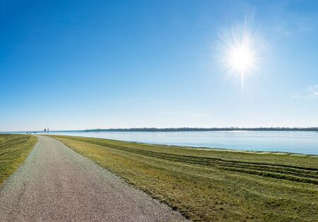 Asphalt walk along bank of Gabcikovo Dam on sunny day