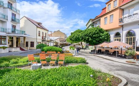 Wooden seats with a lot of green in Pedestrian zone in centre of spa town Piestany (SLOVAKIA) Stock fotó