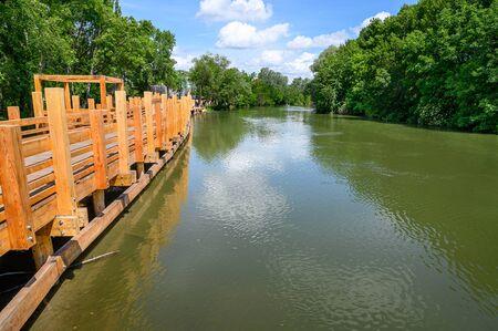 Korzo Zalesie - area for leisure activities with wooden bridge walk by Little Danube river in village of Zalesie (SLOVAKIA) Stock fotó