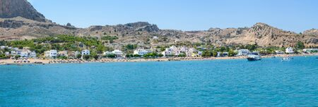 Panoramic view of Stegna beach with apartment houses close to Town of Archangelos (RHODES, GREECE)
