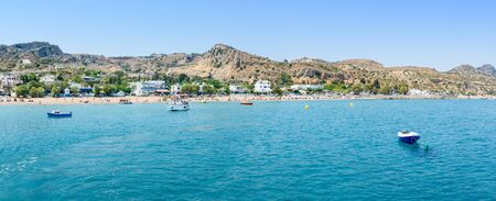 Panoramic view of Stegna beach with anchored small boats (RHODES, GREECE)