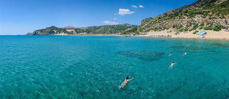 Holidaymakers swim to Tsambika beach (RHODES, GREECE)