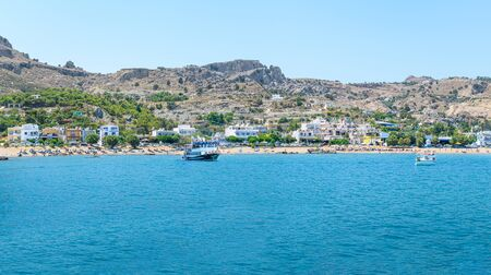 Panoramic view of Stegna beach with anchored tourist boats (RHODES, GREECE)