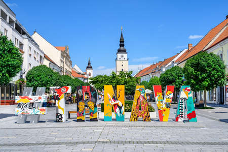TRNAVA, SLOVAKIA – JUNE 25 2020: pedestrian zone of city centre of Trnava with creative hashtag and with town tower in background.