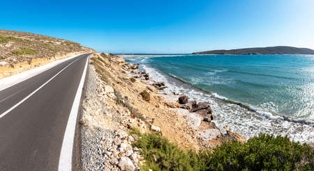 Coastline road to Prasonisi beach with kite surfers in background (Rhodes, Greece)