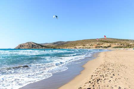 Prasonisi beach with kitesurfers surfing in waves (Rhodes, Greece)