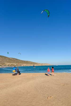 People watching kitesurfers surfing on Prasonisi beach (Rhodes, Greece)