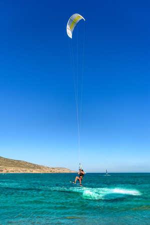 Kitesurfer in jump on Prasonisi beach (Rhodes, Greece)