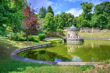 Love Lock Bridge leading to small Roundhouse in water pond in Bojnice castle park (Bojnice, Slovakia)