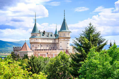 View of neogothic Bojnice castle over treetops of Castle park (Bojnice, Slovakia)