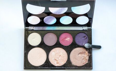 Cosmetics on a white background. Eye shadow palette. Reklamní fotografie
