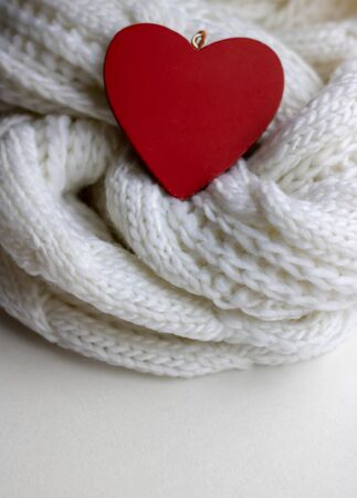 Valentine heart on a white scaf. Background for Valentines day greeting card, concept of romantic celebration Stock Photo - 132051199
