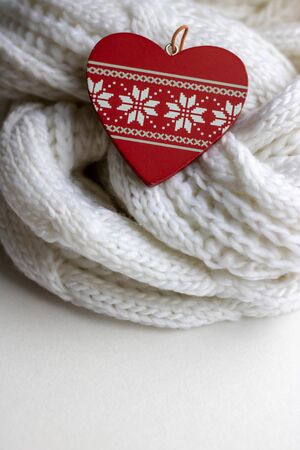 Valentine heart on a white scaf. Background for Valentines day greeting card, concept of romantic celebration.winter