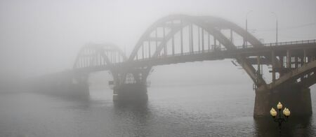 Panorama of the bridge over the river, bridge, river, autumn, travel, vacation, sadness, longing, landscape, nature trees water cloudy weather fog mystic Stok Fotoğraf