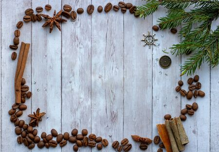 Fragrant coffee beans and hazelnuts. Spices cinnamon, star anise and cloves. Decorations for Christmas and New Year. Background mode. Winter decor.frame.