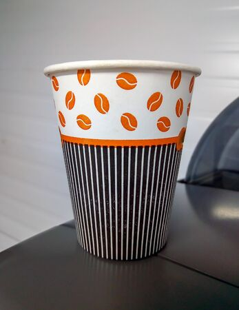 Paper cup with Sleeve ioslated before white background.