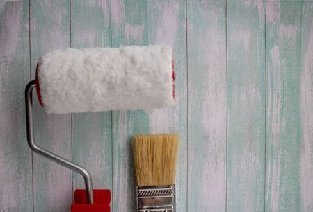 Brushes and rollers for painting on the background of a clean concrete wall.painting tools. Zdjęcie Seryjne