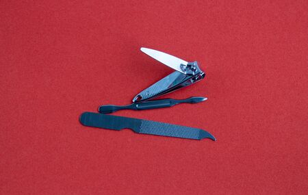 Tools of a manicure set on a red background Imagens