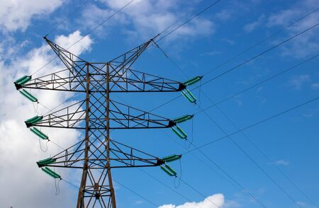 High voltage tower on blue sky background. Silhouette High voltage electric tower. High voltage post or Electricity pole. Electrical equipment