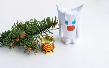 A white bull and a spruce branch with small young cones isolated on a white background.The concept of the New year and Christmas.