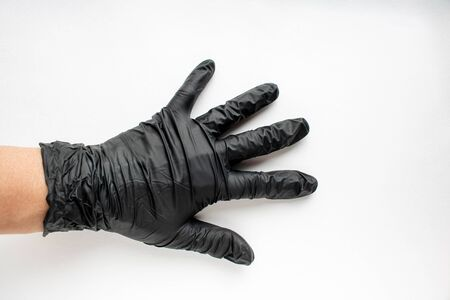 Hand in black gloves, protection. The concept of cleanliness.