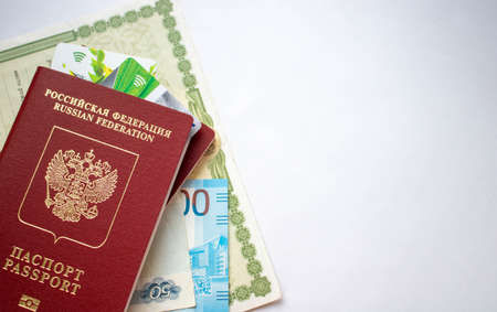 Kotlas, Russia-June 23, 2020. documents, two passports, cards, birth certificate The concept of travel