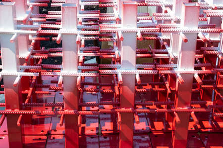 Red and white steel reinforcement for reinforced concrete.texture of a steel reinforcing bar on a construction site