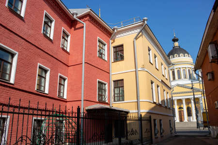 Exterior facade of the red house. Urban vintage background.Bright facades.