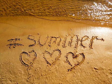 River, sand, the words summer and three hearts.