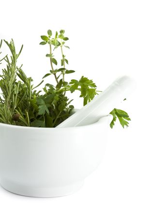Mortar and pestle with herbs photo