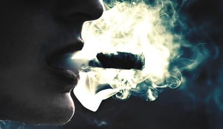 cigar smoking man: Fumar Foto de archivo
